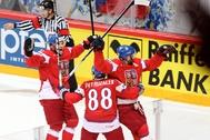 STOCKHOLM, SWEDEN - MAY 17: Czech Republic's Jakub Petruzalek #88 heads in to celebrate 1-2 goal by Jiri Novotny #12 during quarterfinal action at the 2012 IIHF World Championship. (Photo by Andre Ringuette/HHOF-IIHF Images)