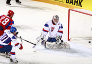 HELSINKI, FINLAND - MAY 20: A shot by Russia's Alexander Syomin #28 gets past Slovakia's Jan Laco #50 during gold medal game action at the 2012 IIHF World Championship. (Photo by Jeff Vinnick/HHOF-IIHF Images)