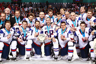 HELSINKI, FINLAND - MAY 20:  Team Slovakia with the silver plate after the gold medal game at the 2012 IIHF World Championship. (Photo by Jeff Vinnick/HHOF-IIHF Images)
